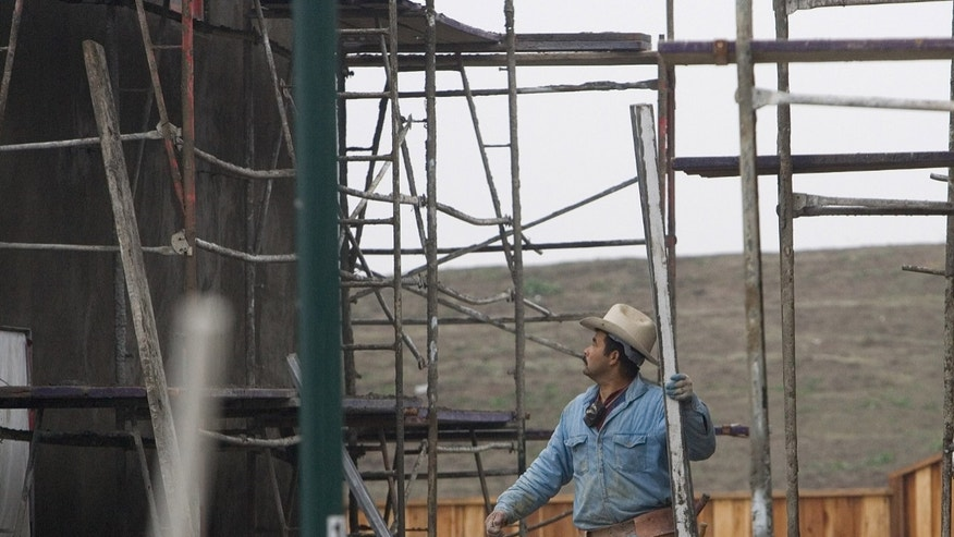 SAN RAMON, CA - DECEMBER 28:  A laborer works on the construction of a new home development December 28, 2007 in San Ramon, California. The Commerce Department reported December 28 that the sales of new homes in the U.S. dropped to the lowest level in 12 years for the month of November.  (Photo by David Paul Morris/Getty Images)
