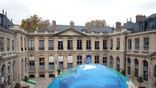 An globe-like tent hosting an exhibition on climate is set up in the courtyard of the French Environment ministry as part of the Nov. 30-Dec. 11 climate conference, in Paris, France, Friday, Nov. 6, 2015. Some 80 heads of state including President Barack Obama, and tens of thousands of other people, are expected in Paris for the conference opening. (AP Photo/Thibault Camus)