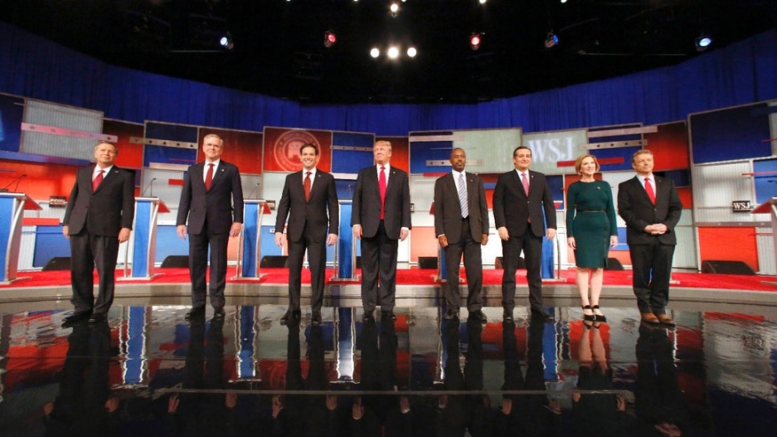 Republican presidential candidates John Kasich, Jeb Bush, Marco Rubio, Donald Trump, Ben Carson, Ted Cruz, Carly Fiorina and Rand Paul take the stage before the Republican presidential debate at the Milwaukee Theatre, Tuesday, Nov. 10, 2015, in Milwaukee. (AP Photo/Jeffrey Phelps)