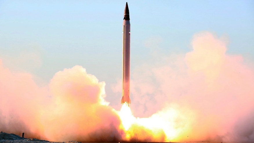 "Oct. 11, 2015 – Photo claims to show launching of an Emad long-range ballistic surface-to-surface missile in an undisclosed location. Iran tested a ballistic missile again in November 2015, a U.S. official said Dec. 8, describing the 2nd such test since this summer's nuclear agreement. The State Department said only that it was conducting a ""serious review"" of such reports. (Iranian Defense Ministry via AP)"