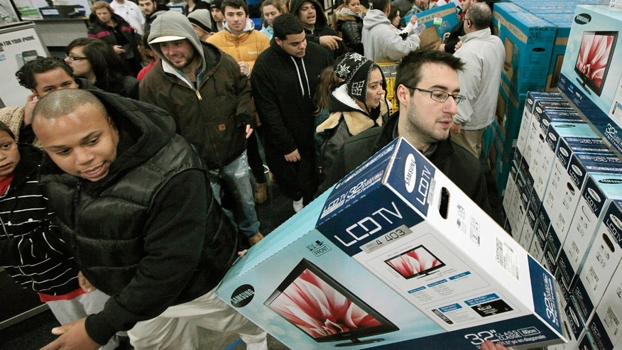 FILE -- Nov. 25, 2011: Black Friday shoppers rush into Best Buy in North Dartmouth, Mass.