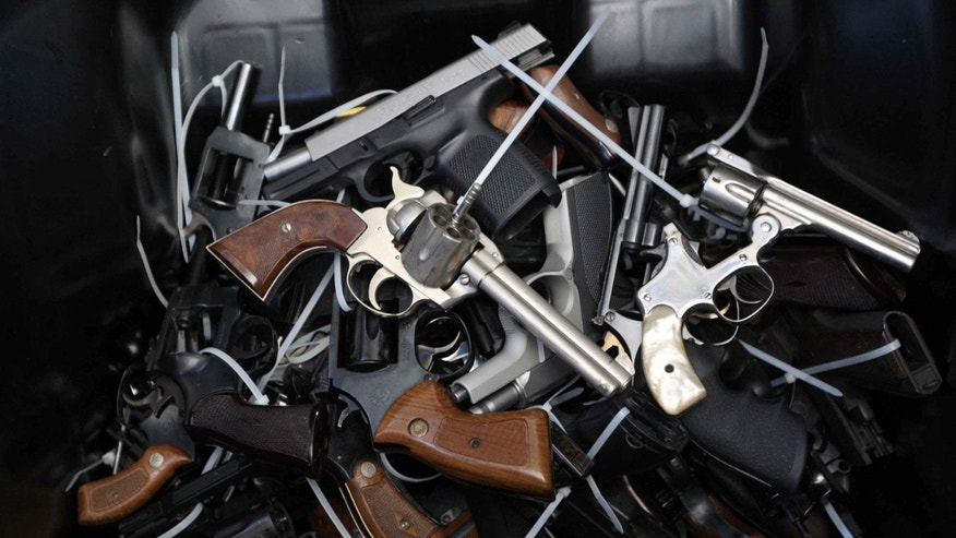 LOS ANGELES, CA - MAY 31:  Surrendered handguns are piled in a bin during a gun buyback event that was announced by Los Angeles Mayor Eric Garcetti in the wake of a killing spree at University of California, Santa Barbara that left six students dead, on May 31, 2014 in Los Angeles, California. People can exchange their firearms with no questions asked at four Los Angles-area locations for Ralphs supermarket gift cards ranging from $100 to $200 per weapon. The buyback program first took place in Los Angles in 2009 as part of the Gang Reduction and Youth Development program to reduce the number of guns on the streets. The last buyback resulted in more than 1,500 firearms being turned in. (Photo by David McNew/Getty Images)