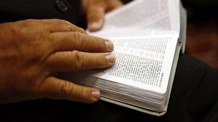 FILE -- A man reads the Bible in Florida. (Corey Perrine/Naples Daily News via AP)
