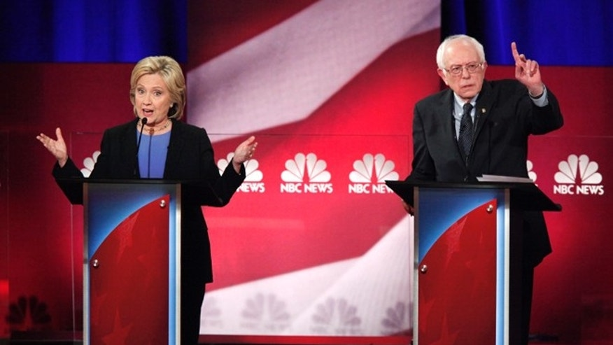 Democratic U.S. presidential candidate and former Secretary of State Hillary Clinton (L) and rival candidate U.S. Senator Bernie Sanders (R) speak simultaneously at the NBC News - YouTube Democratic presidential candidates debate in Charleston, South Carolina January 17, 2016. REUTERS/Randall Hill  - RTX22TE2
