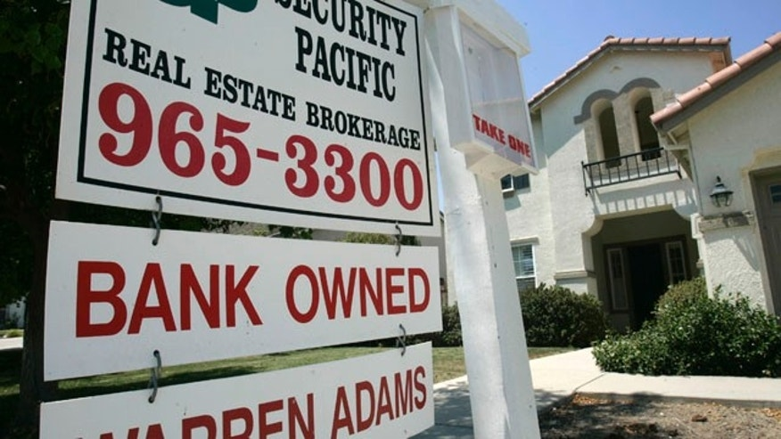 FILE - July 2, 2008: A bank owned home is seen for sale in Sacramento, Calif.