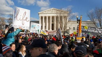 FILE -- Jan. 22, 2015: Anti-abortion demonstrators march past the Supreme Court in Washington during the annual March for Life.