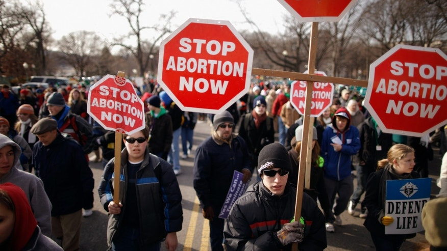 WASHINGTON, DC - JANUARY 24:  Tens of thousands of anti-abortion demonstrators march along Constitution Avenue toward the Supreme Court during the March for Life January 24, 2011 in Washington, DC. The annual march marks the anniversary of the landmark Roe v. Wade decision by the court that made abortion legal in the United States.  (Photo by Chip Somodevilla/Getty Images)