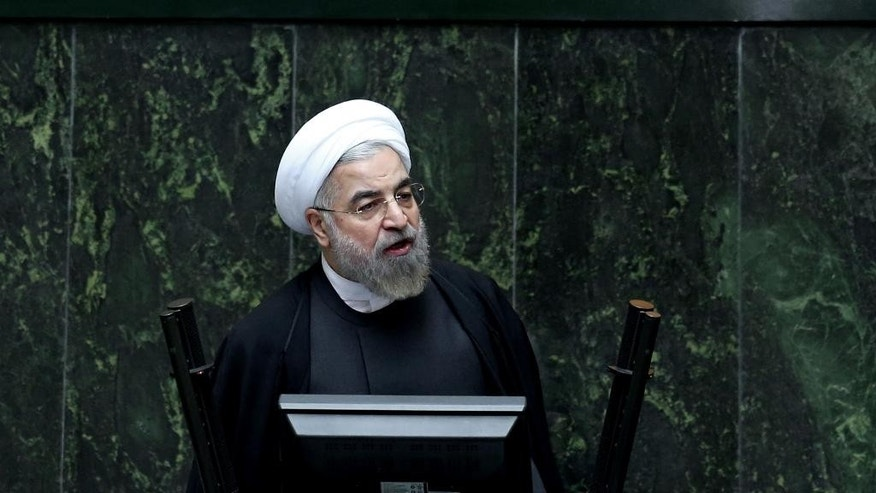 FILE - Oct. 29, 2014: Iranian President Hassan Rouhani speaks during a debate on a vote of confidence for his choice for the new minister of Science, Research and Technology, Mahmoud Nili Ahmadabadi, in an open session of parliament in Tehran, Iran.