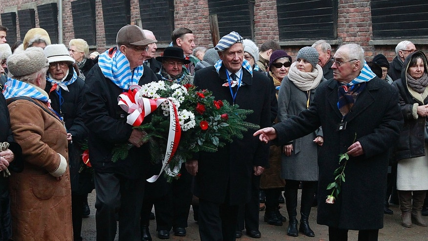 Holocaust survivors commemorate the people killed by the Nazis at the former Auschwitz Nazi death camp in Oswiecim, Poland, Wednesday, Jan. 27, 2016,  the International Holocaust Remembrance Day that marks  the liberation of the Auschwitz Nazi death camp on Jan. 27, 1945. (AP Photo/Czarek Sokolowski)