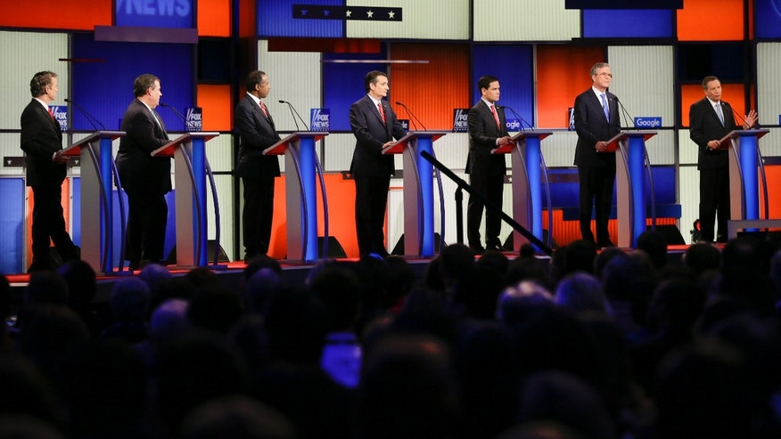 Republican presidential candidate Ohio Gov. John Kasich, right, answers a question as (L-R) Sen. Rand Paul, R-Ky., New Jersey Gov. Chris Christie, retired neurosurgeon Ben Carson, Sen. Ted Cruz, R-Texas, Sen. Marco Rubio, R-Fla., and former Florida Gov. Jeb Bush listen during a Republican presidential primary debate, Thursday, Jan. 28, 2016, in Des Moines, Iowa. (AP Photo/Charlie Neibergall)