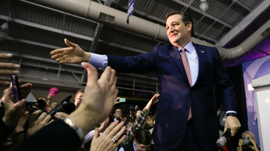 Republican presidential candidate, Sen. Ted Cruz, R-Texas, greets supporters  during a caucus night rally, Monday, Feb. 1, 2016, in Des Moines, Iowa. Cruz sealed a victory in the Republican Iowa caucuses, winning on the strength of his relentless campaigning and support from his party's diehard conservatives. (AP Photo/Charlie Neibergall)