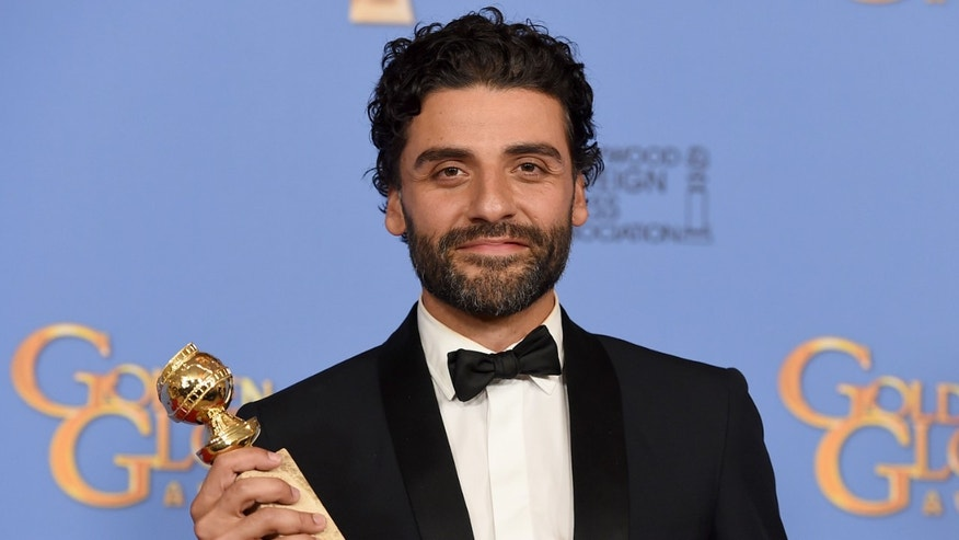 "Oscar Isaac poses in the press room with the award for best performance by an actor in a series, limited series or motion picture for television for ""Show Me a Hero"" at the 73rd annual Golden Globe Awards on Sunday, Jan. 10, 2016, at the Beverly Hilton Hotel in Beverly Hills, Calif. (Photo by Jordan Strauss/Invision/AP)"
