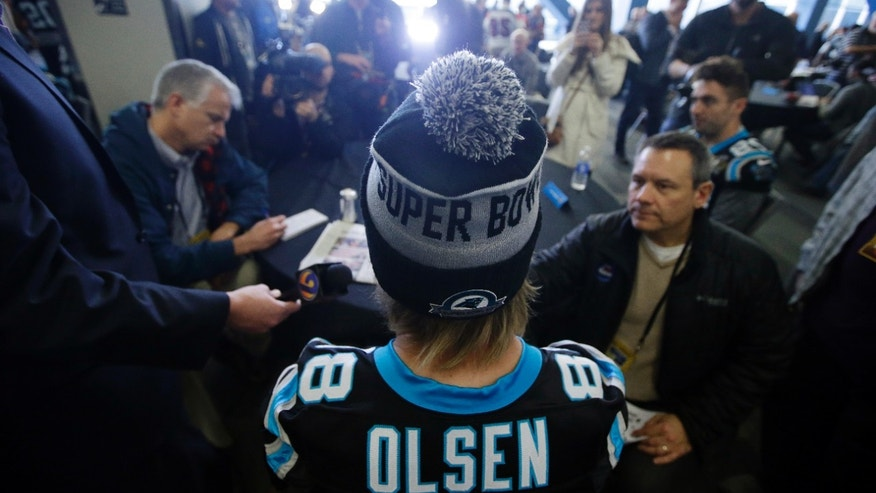 Carolina Panthers tight end Greg Olsen (88) answers questions during a press conference in preparation for the Super Bowl 50 football game Thursday Feb. 4, 2016 in San Jose, Calif. (AP Photo/Marcio Jose Sanchez)