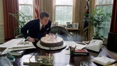 Feb. 5, 1982: President Reagan blows out candles on his birthday cake in the Oval Office.