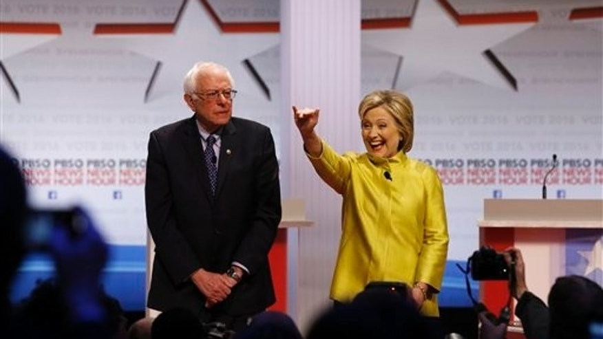 Democratic presidential candidates Sen. Bernie Sanders, I-Vt., and Hillary Clinton take the stage before a primary debate at the University of Wisconsin-Milwaukee, Feb. 11, 2016, in Milwaukee. (AP Photo/Tom Lynn)