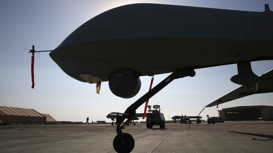 UNSPECIFIED, UNSPECIFIED - JANUARY 07:  U.S. Air Force MQ-1B Predator unmanned aerial vehicles (UAVs), prepare to launch from a secret air base in the Persian Gulf region on January 7, 2016. The U.S. military and coalition forces use the base, located in an undisclosed location, to launch drone airstrikes against ISIL in Iraq and Syria, as well as to distribute cargo and transport troops supporting Operation Inherent Resolve. The Predators at the base are operated and maintained by the 46th Expeditionary Reconnaissance Squadron, currently attached to the 386th Air Expeditionary Wing.  (Photo by John Moore/Getty Images)