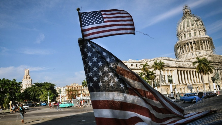 "US flags are seen in a bici-taxi near the capitol in Havana on January 23, 2015. Hours into historic US-Cuba talks in Havana, a Cuban official came out to boast about the ""relaxed"" atmosphere at the meeting between the old Cold War adversaries. After barely speaking face-to-face since the 1960s, the United States and Cuba took big steps toward normalizing ties by holding a two-day meeting, even though the talks highlighted enduring rifts between the nations. AFP PHOTO / Yamil LAGE        (Photo credit should read YAMIL LAGE/AFP/Getty Images)"