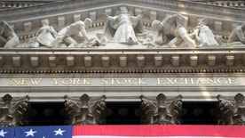 FILE - In this July 6, 2015 file photo, an American flag is draped on the exterior of the New York Stock Exchange. U.S. stocks edged mostly higher in early trading Friday, Oct. 16, 2015, extending gains from the day before. Investors pored over the latest corporate earnings news. The price of oil rose. (AP Photo/Mark Lennihan, File)