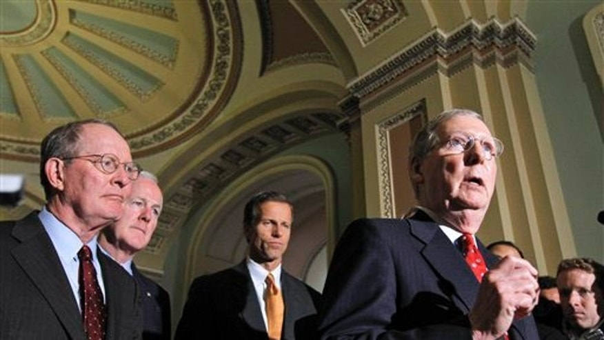 Senate Minority Leader Mitch McConnell of Ky., right, talks to reporters on Capitol Hill in Washington, Tuesday, Sept. 21, 2010, prior to the Senate vote on the defense authorization bill. From left are, Sen. Lamar Alexander, R-Tenn., Sen. John Cornyn, R-Texas, and Sen. John Thune, R-S.D., and McConnell.