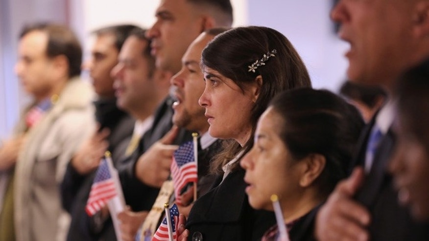 NEWARK, NJ - NOVEMBER 20:  Immigrants take oath of citizenship to the United States on November 20, 2014 in Newark, New Jersey. Sixty immigrants from 25 countries became American citizens during the naturalization ceremony at the U.S. Immigration and Citizenship Services (USCIS) office at Newark's Federal Building.  (Photo by John Moore/Getty Images)