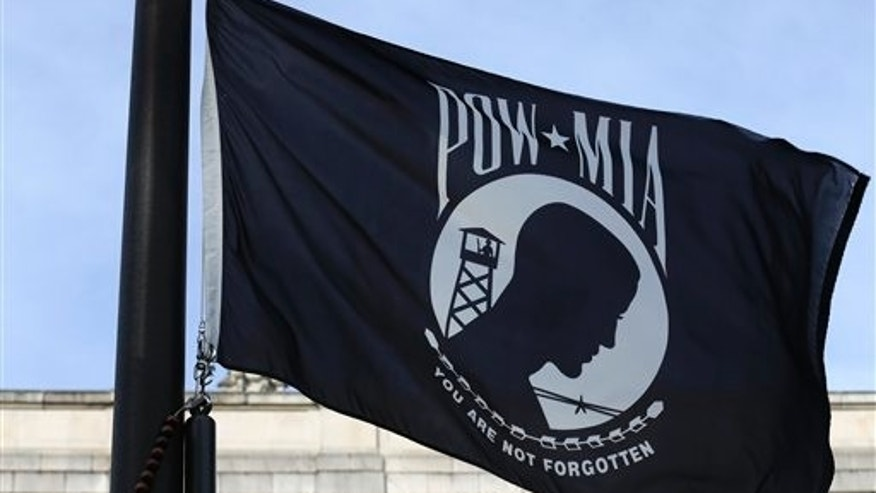 A POW/MIA flag flies Friday, Sept. 20, 2013, in Olympia, Wash., on National POW/MIA Recognition Day. (AP Photo/Ted S. Warren)