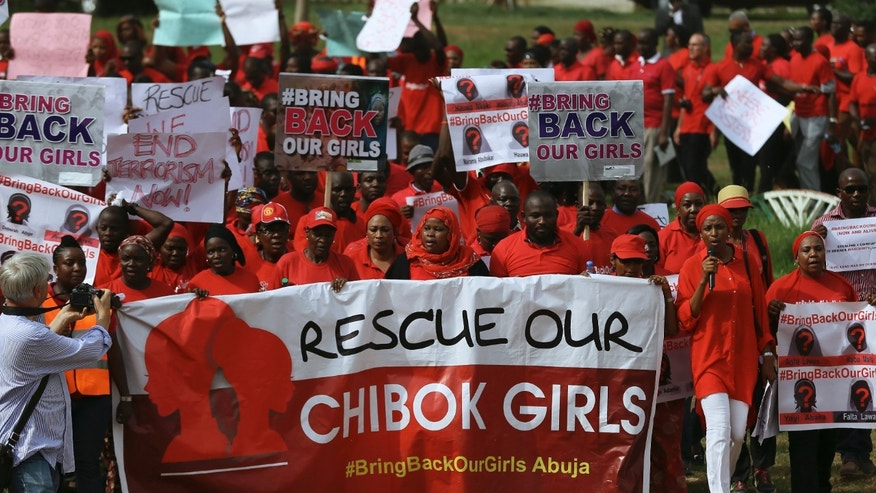 "May 22, 2014 - FILE photo of the ""Bring Back Our Girls"" protest group march to the presidential villa to deliver a protest letter to Nigeria's President Goodluck Jonathan calling for the release of the Nigerian schoolgirls in Chibok who were kidnapped by Islamist militant group Boko Haram."