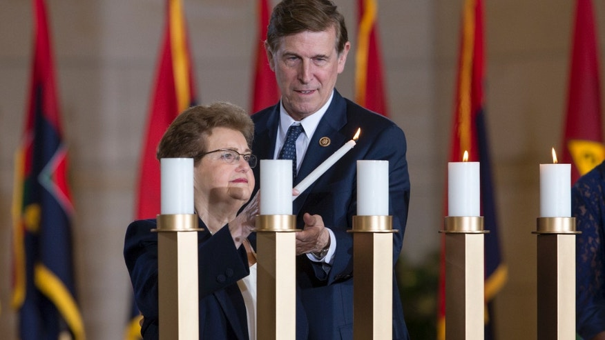 May 5, 2016: Holocaust survivor Rose Reichbach, left, is assisted by Rep. Don Beyer D-Va. in lighting a candle as the U.S. Holocaust Memorial Museum holds its annual Days of Remembrance Ceremony, on Capitol Hill in Washington, to honor the victims of the Holocaust and Nazi persecution. Rose Reichbach and her family fled from their native Poland to Belarus during the Nazi invasion. (AP Photo/J. Scott Applewhite)