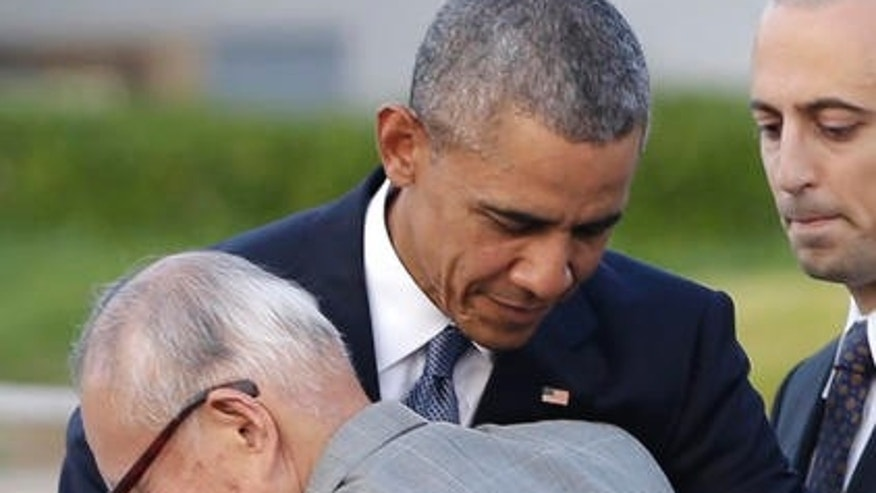 U.S. President Barack Obama hugs Shigeaki Mori, an atomic bomb survivor; creator of the memorial for American WWII POWs killed at Hiroshima, during a ceremony at Hiroshima Peace Memorial Park in Hiroshima, western, Japan, Friday, May 27, 2016. Obama on Friday became the first sitting U.S. president to visit the site of the world's first atomic bomb attack, bringing global attention both to survivors and to his unfulfilled vision of a world without nuclear weapons. (AP Photo/Carolyn Kaster)