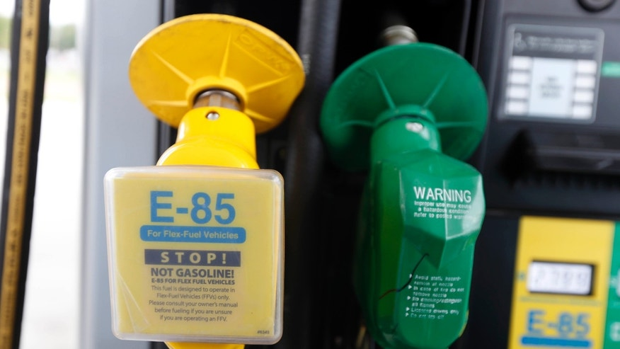FILE - Aug. 9, 2014: A fuel nozzle for E-85, left, and traditional gasoline is seen at a gas station in Batesville, Miss.