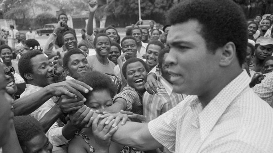 In this Sept. 17, 1974, file photo, Muhammad Ali is greeted in downtown Kinshasa, Zaire