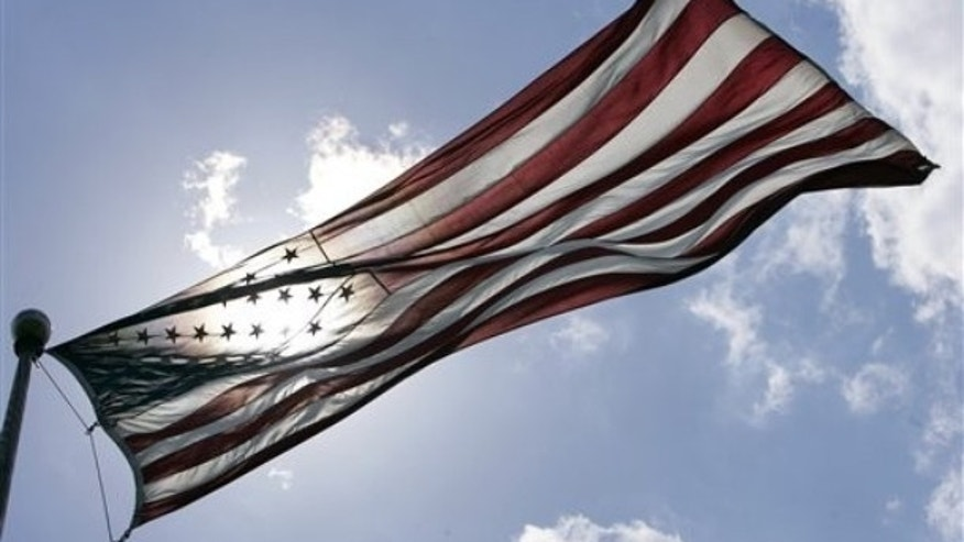 FILE -- An American flag flies at Liberty State Park in Jersey City, N.J.