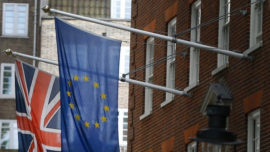 FILE -- The Union flag and the European Union flag fly outside Europe House, The European Commission Representation in London.