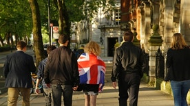 Vote Leave supporters walk along a street in central London, Friday, June 24, 2016. Britain entered uncharted waters Friday after the country voted to leave the European Union, according to a projection by all main U.K. broadcasters. (AP Photo/Matt Dunham)