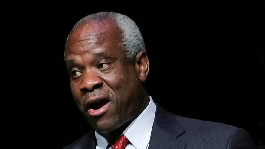 FILE -- Supreme Court Justice Clarence Thomas