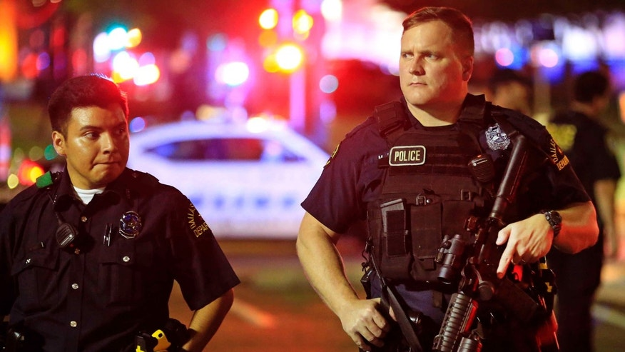 Dallas police near the scene where four police officers were shot and killed on July 7, 2016.