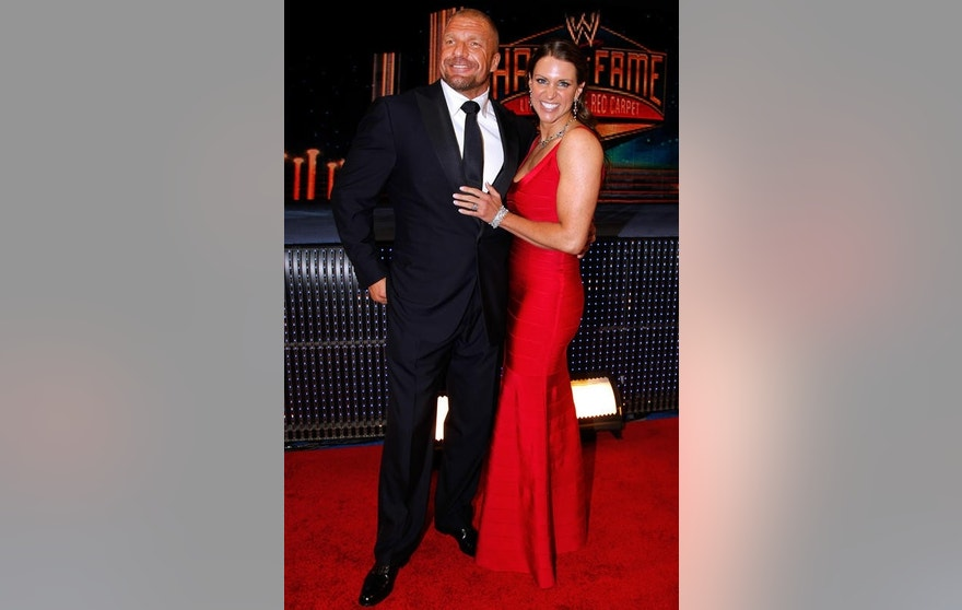 IMAGE DISTRIBUTED FOR WWE - Paul Levesque aka Triple H and Stephanie McMahon are seen at the WWE Hall of Fame Induction at the Smoothie King Center in New Orleans on Saturday, April 5, 2014. (Jonathan Bachman/AP Images for WWE)