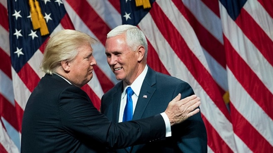 NEW YORK, NY - JULY 16: (L to R) Republican presidential candidate Donald Trump greets his newly selected vice presidential running mate Mike Pence, governor of Indiana, as he takes the stage during an event at the Hilton Midtown Hotel, July 16, 2016 in New York City. On Friday, Trump announced on Twitter that he chose Pence to be his running mate. (Photo by Drew Angerer/Getty Images)