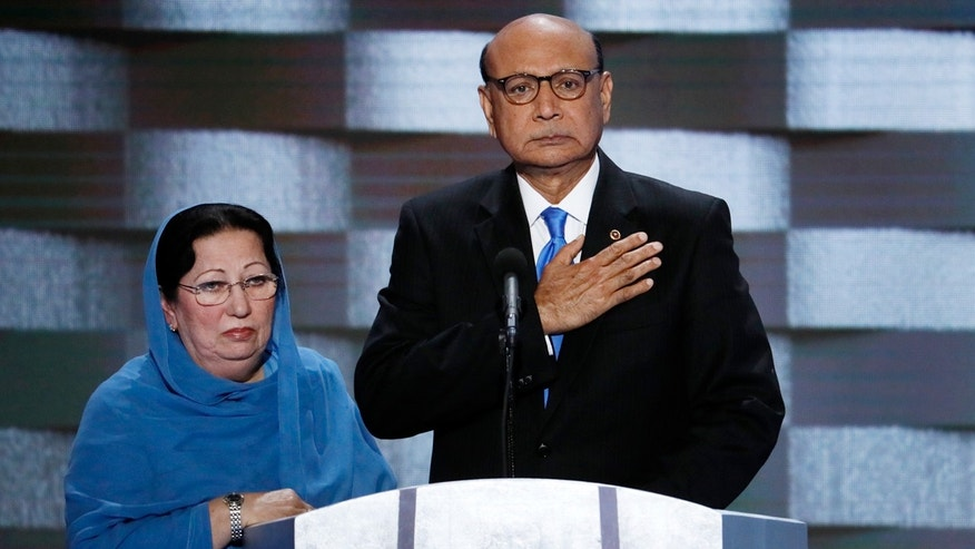 FILE - July 28, 2016: Khizr Khan, father of fallen US Army Capt. Humayun S. M. Khan and his wife Ghazala speak during the final day of the Democratic National Convention in Philadelphia.