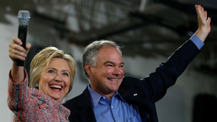 Democratic U.S. presidential candidate Hillary Clinton and U.S. Senator Tim Kaine (D-VA) wave to the crowd during a campaign rally at Ernst Community Cultural Center in Annandale, Virginia, U.S., July 14, 2016.  REUTERS/Carlos Barria - RTSHZ26