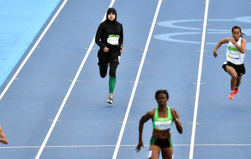 Saudi Arabia's Kariman Abuljadayel competes in a women's 100-meter heat during the athletics competitions of the 2016 Summer Olympics at the Olympic stadium in Rio de Janeiro, Brazil, Friday, Aug. 12, 2016. (AP Photo/Martin Meissner)