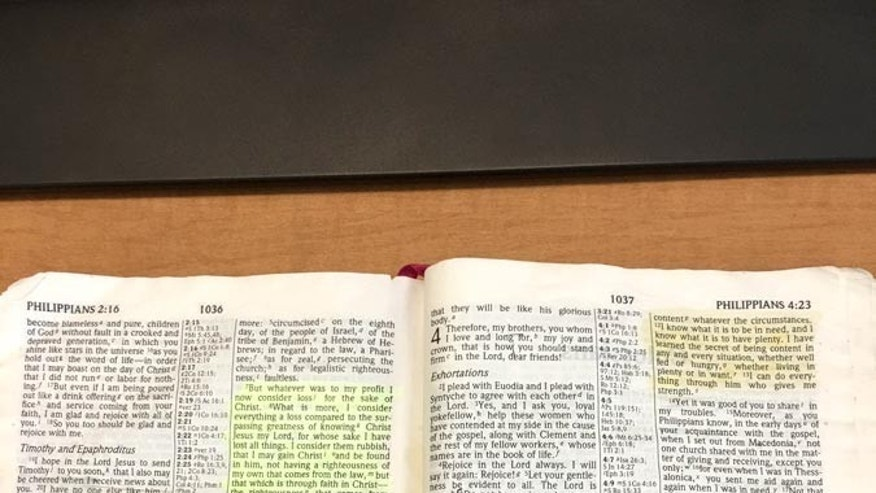 The Bible on the desk of Maj. Steve Lewis.