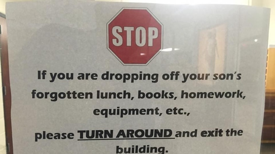 The sign hanging on the door at the Catholic High School for boys in Little Rock, Arkansas.