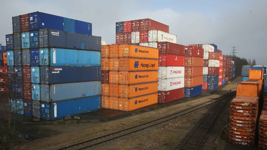 HAMBURG, GERMANY - MARCH 04:  Stacked shipping containers stand next to railway lines at a terminal at Hamburg Port on March 4, 2016 in Hamburg, Germany. According to the most recent data Germany has the highest trade surplus in the world, at EUR 285 billion for 2014. Its major exports include cars and other vehicles, as well as machinery, chemicals and pharmaceuticals.  (Photo by Sean Gallup/Getty Images)