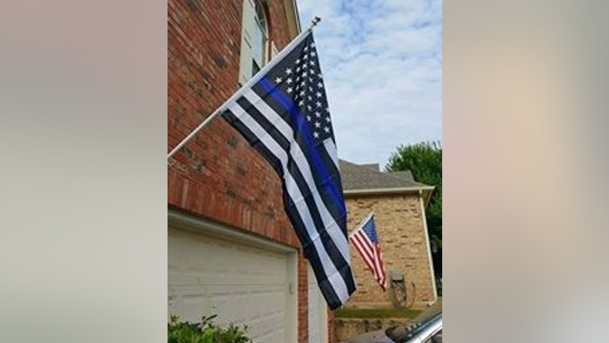 The black and white version of the U.S. flag adorned with a blue stripe.