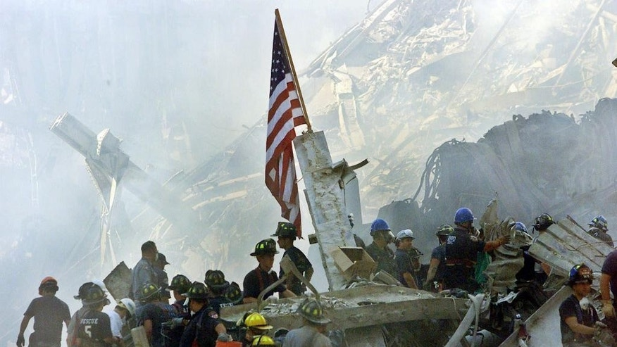 FILE - Sept. 13, 2001 an American flag flies over the rubble of the collapsed World Trade Center buildings in New York.