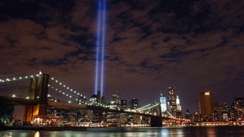 Sept 10: The Tribute in Light rises over the Brooklyn Bridge and lower Manhattan.