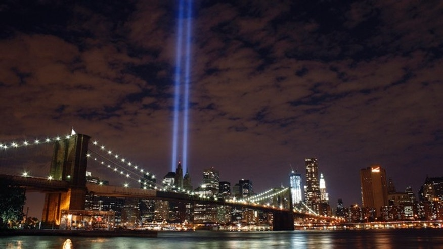 FILE -- The Tribute in Light rises over the Brooklyn Bridge and lower Manhattan.