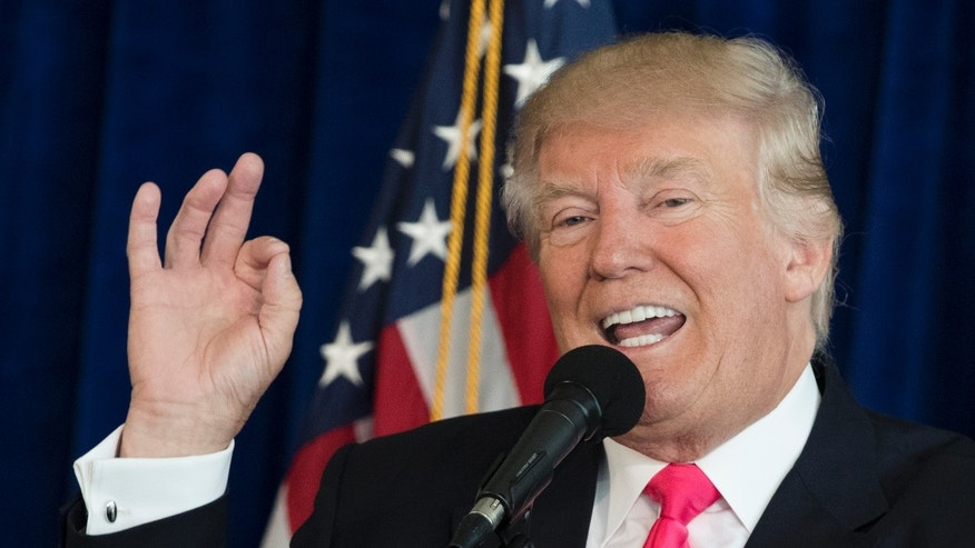 FILE- Republican presidential candidate Donald Trump speaks during a news conference.