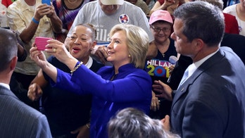 Democratic presidential candidate Hillary Clinton meets and greets supporters during a campaign stop in Orlando, Fla., Wednesday, Sept. 21, 2016.  (Joe Burbank/Orlando Sentinel via AP)
