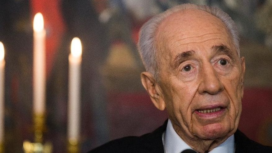FILE- The President of Israel, Shimon Peres answers questions at a press meeting on the first day of his official visit to Norway in Oslo,Monday May 12, 2014.